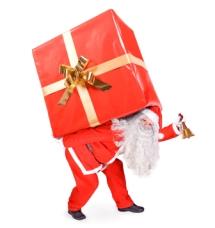 Santa Claus carries a big present